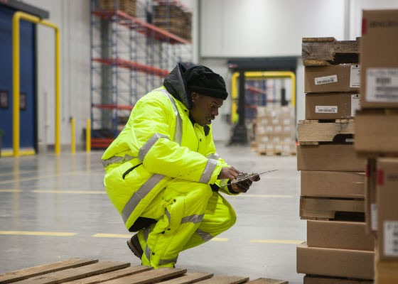 Warehouse worker scanning boxes